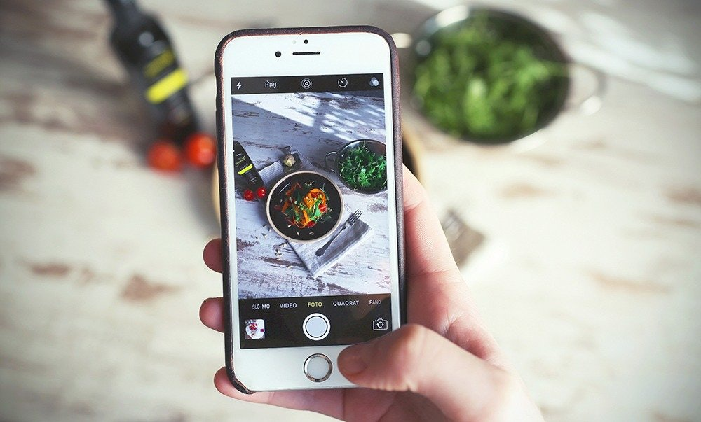 iphone taking a photo of food