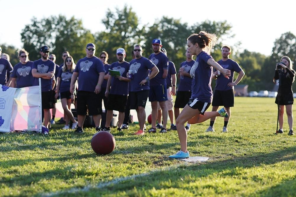 woman kicking a ball on a sports team