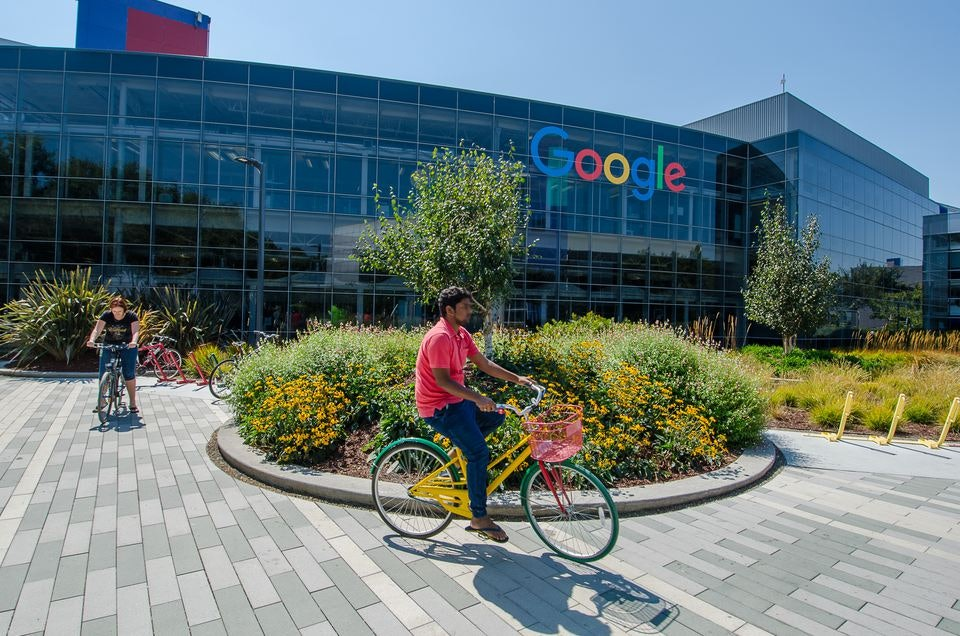 Google Headquarters with Biker in Front of Building