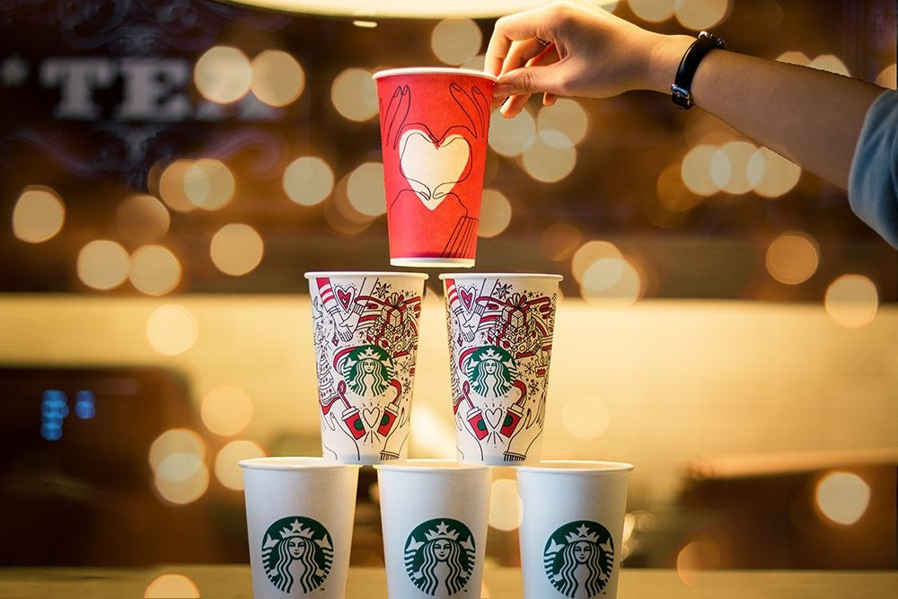 Six Starbucks Cups Stacked in a Pyramid