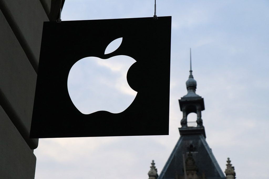 Black Apple Sign in Front of Amsterdam Sky
